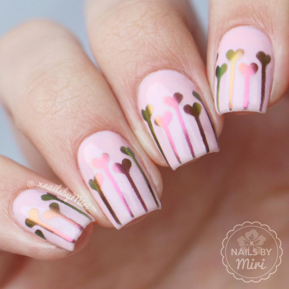 Beautiful Golden Heart Balloons On Pink Nails