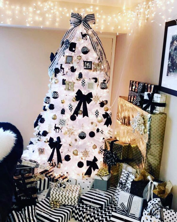 Black, white and gold ornaments on white Christmas tree with stripes ribbon. Pic by heather29b