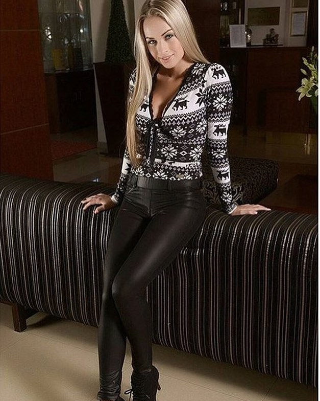 Charismatic Black & White Sweater Paired With Leather Pant