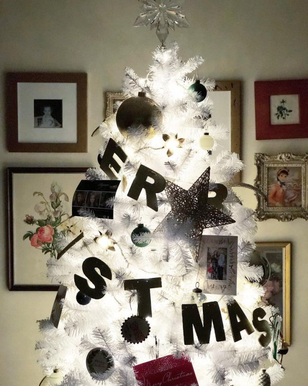 Charming black ornaments on white Christmas tree with lights. Pic by dearme79