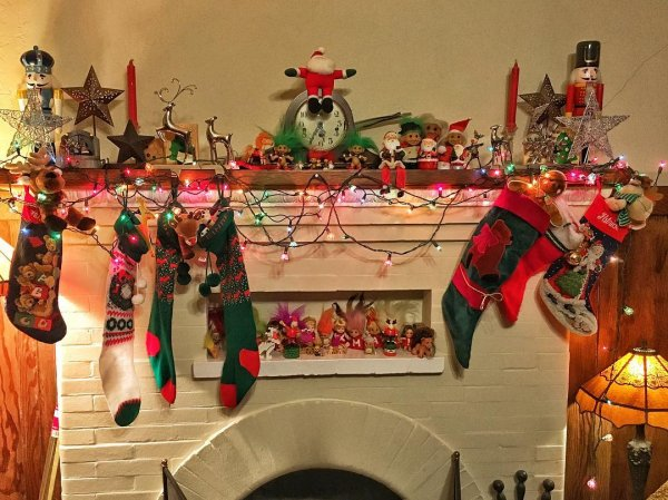 Christmas stockings and toys for mantel decor. Pic by swimmersuze