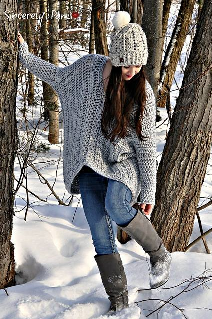 Cozy Soft Oversized Sweater With Same Cap Paired With Blue Jeans And High Boots