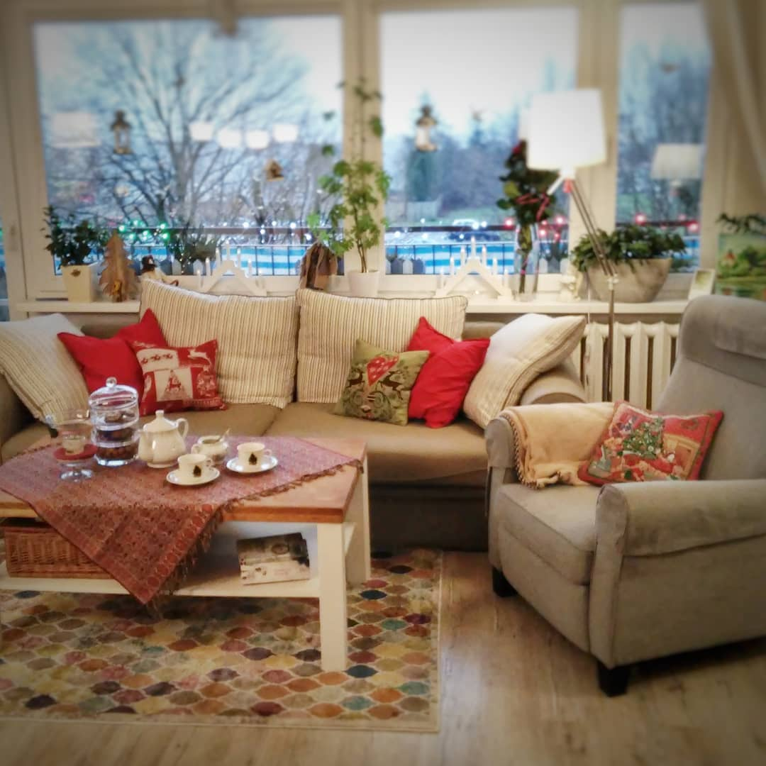 Cozy living room with Christmas theme pillow cover. Pic by lvlupstudio