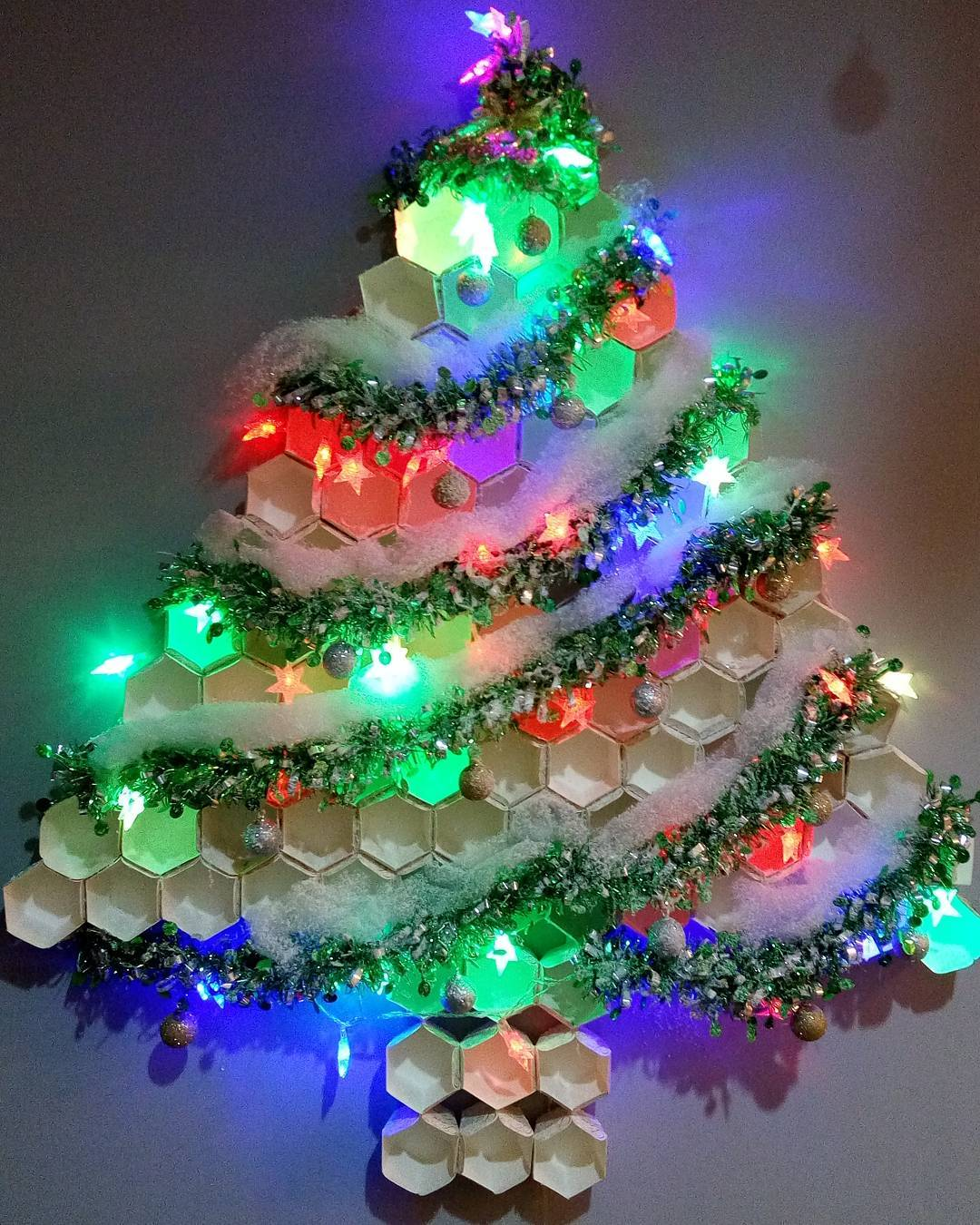 Creative Cup Cake Alternative Christmas Tree Decorated With Lights And Ornaments