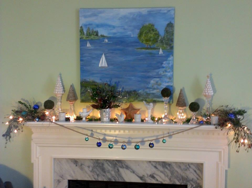 Crystal Candle Sticks Used To Decorate Coastal Cottage Mantel