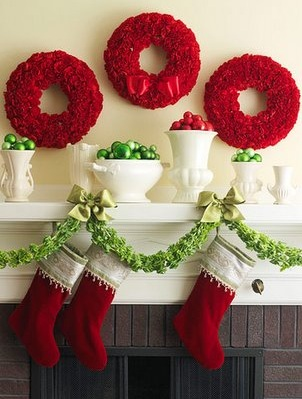 Decorative Red Wreath, Bells Of Ireland Garland And Red & Green Ornaments Used To Decorate Mantel
