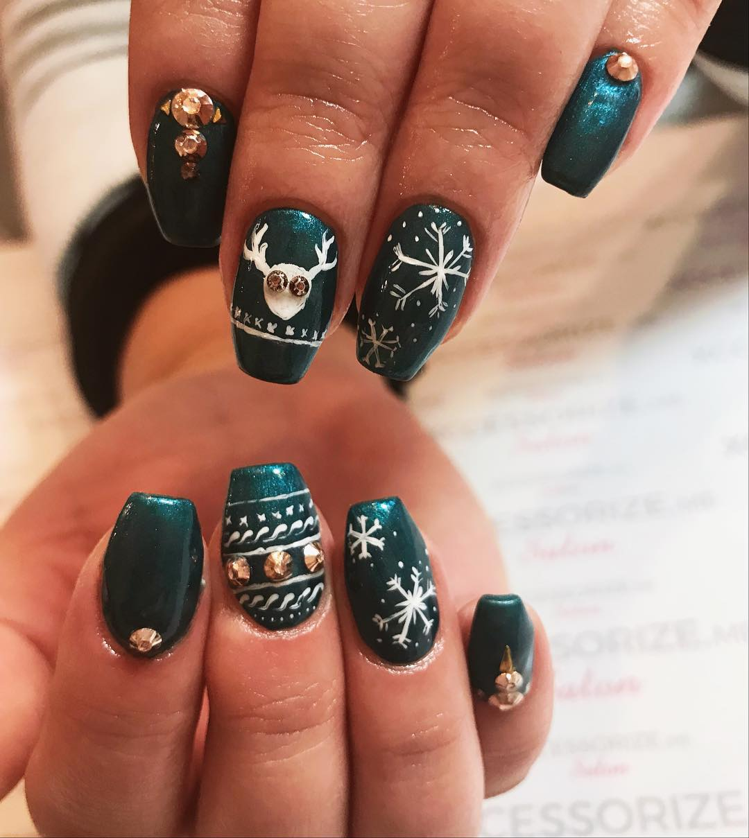Designer Snowflakes And Reindeer Nails