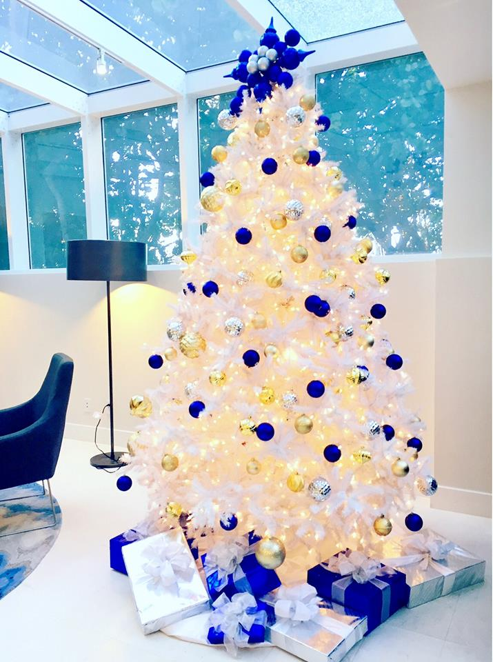 dreamy blue silver and golden balls used to decorate white christmas tree