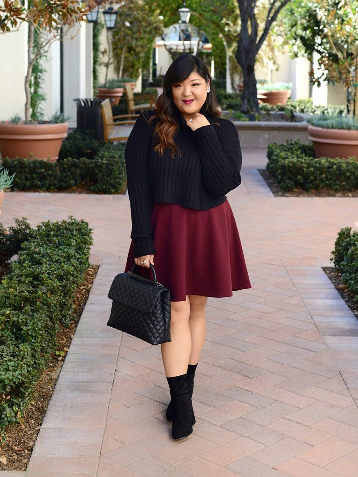 Elegant Black Sweater Paired With Maroon Skirt, Ankle Shoes And Leather Handbag