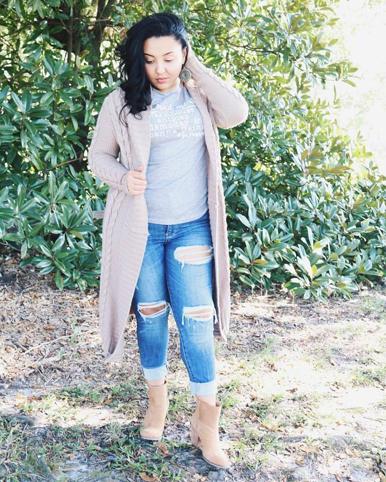 Elegant Grey T-Shirt, Blue Ripped Jeans Paired With Long Sweater
