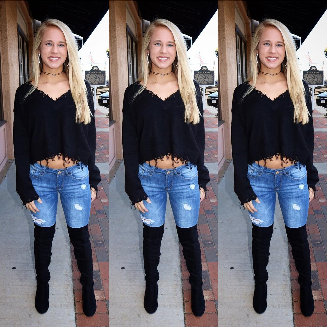 Fantastic V-Neck Black Short Sweater With Blue Jeans And Knee Shoes