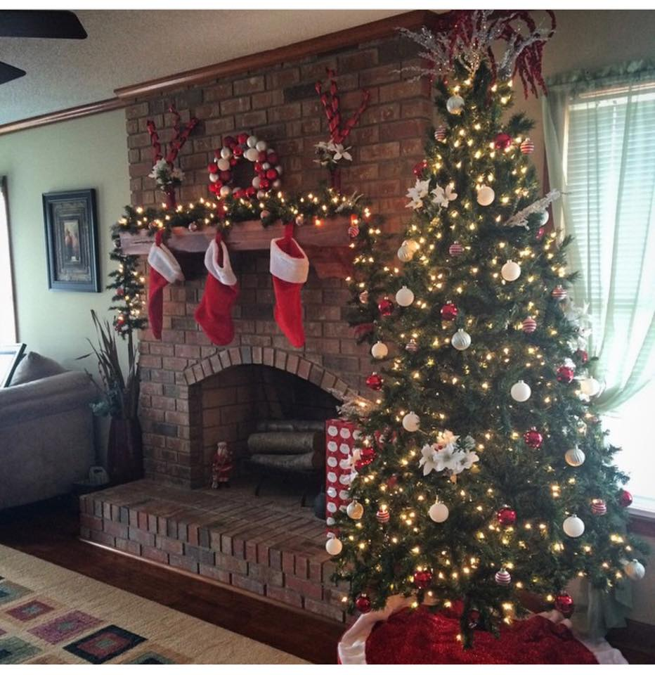 Fresh Garland, Wreath, Tree, Stocking All Are Decorated With Lights