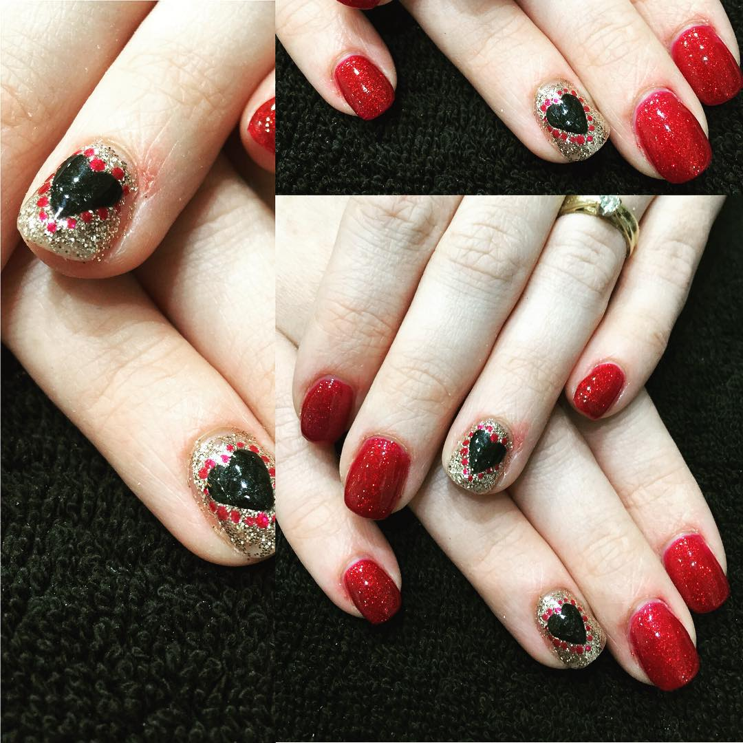 Glittery Red Nails With Black Heart
