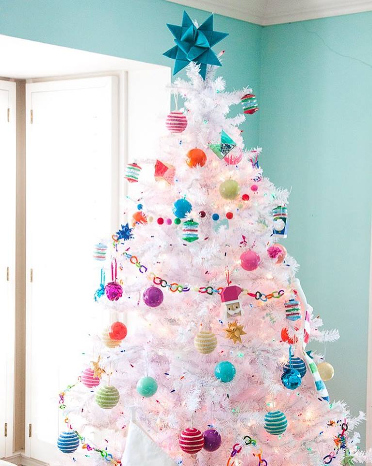 Glowing Colored Ornaments On Fabulous White Christmas Tree