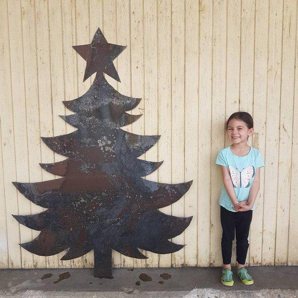 Metal Christmas tree with rust.