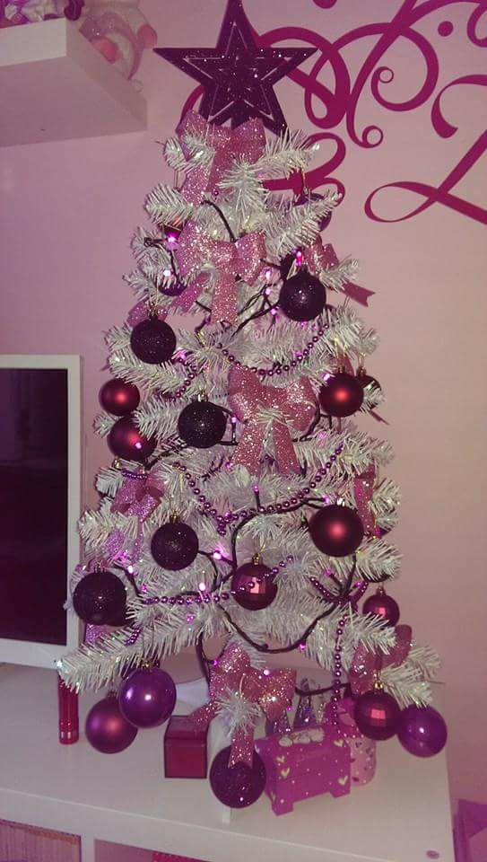 Pinkish And Purple Ornaments On White Christmas Tree