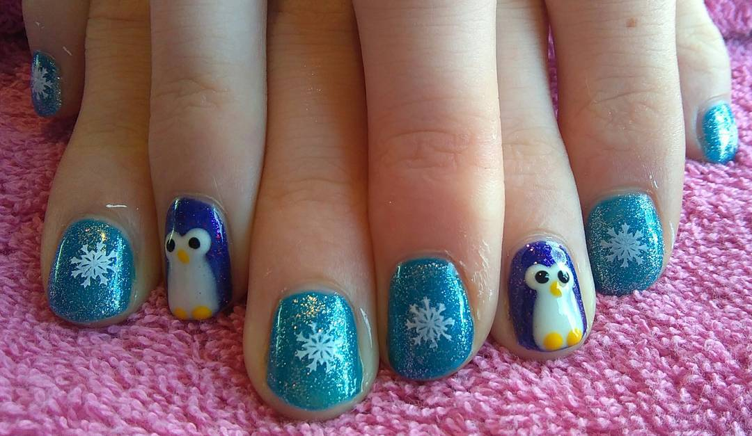 Pretty Blue Snowflakes Nails With Snowman
