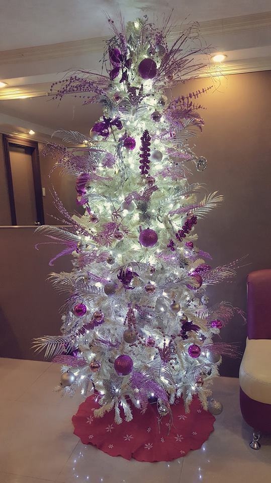 Purple And Silver Balls Hanging On Tree