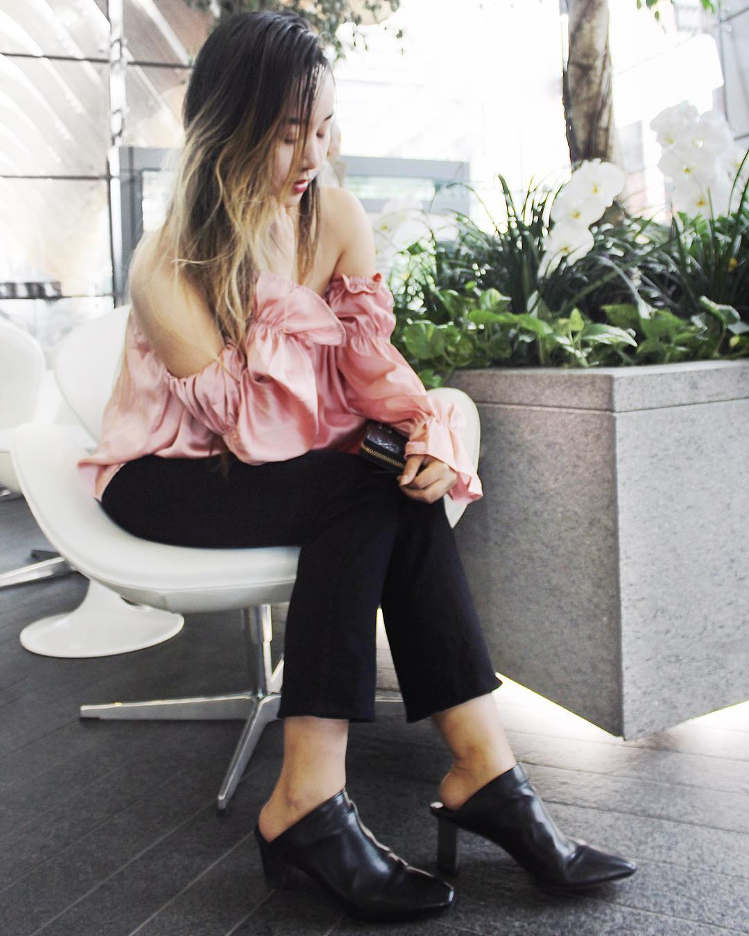 Ravishing Pink Off The Shoulder Ruffle Sleeves Top Dressed With Simple Black Cropped Pant