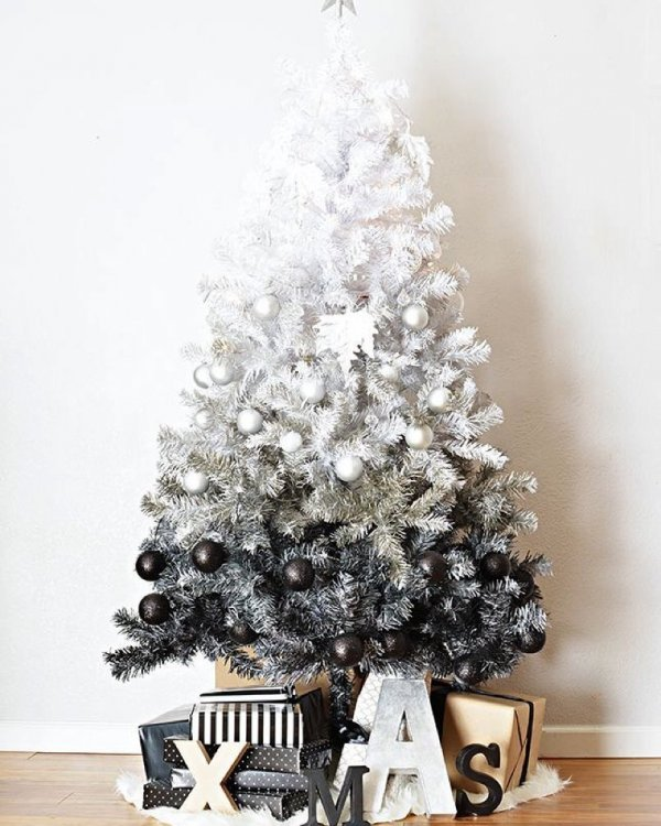 Ravishing white and black Christmas tree with wooden alphabets. Pic by hollyk8o