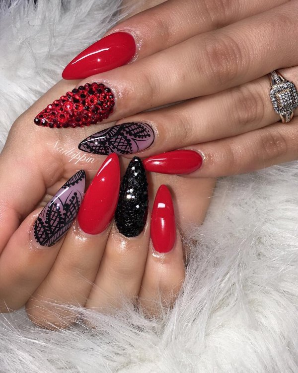 Red and black nails with swarovski crystals. Pic by nailtippin