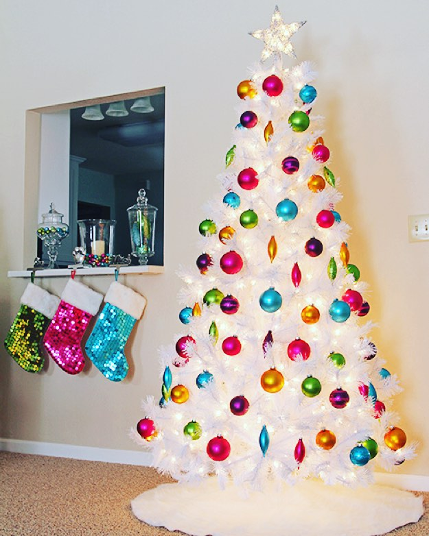 Simple And Beautiful White Christmas Tree Decorated With Colored Ornaments