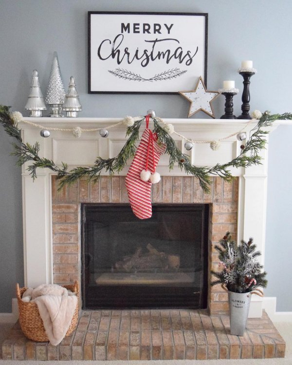 Simple farmhouse style mantel decor for Christmas. Pic by simpleinspirationsathome