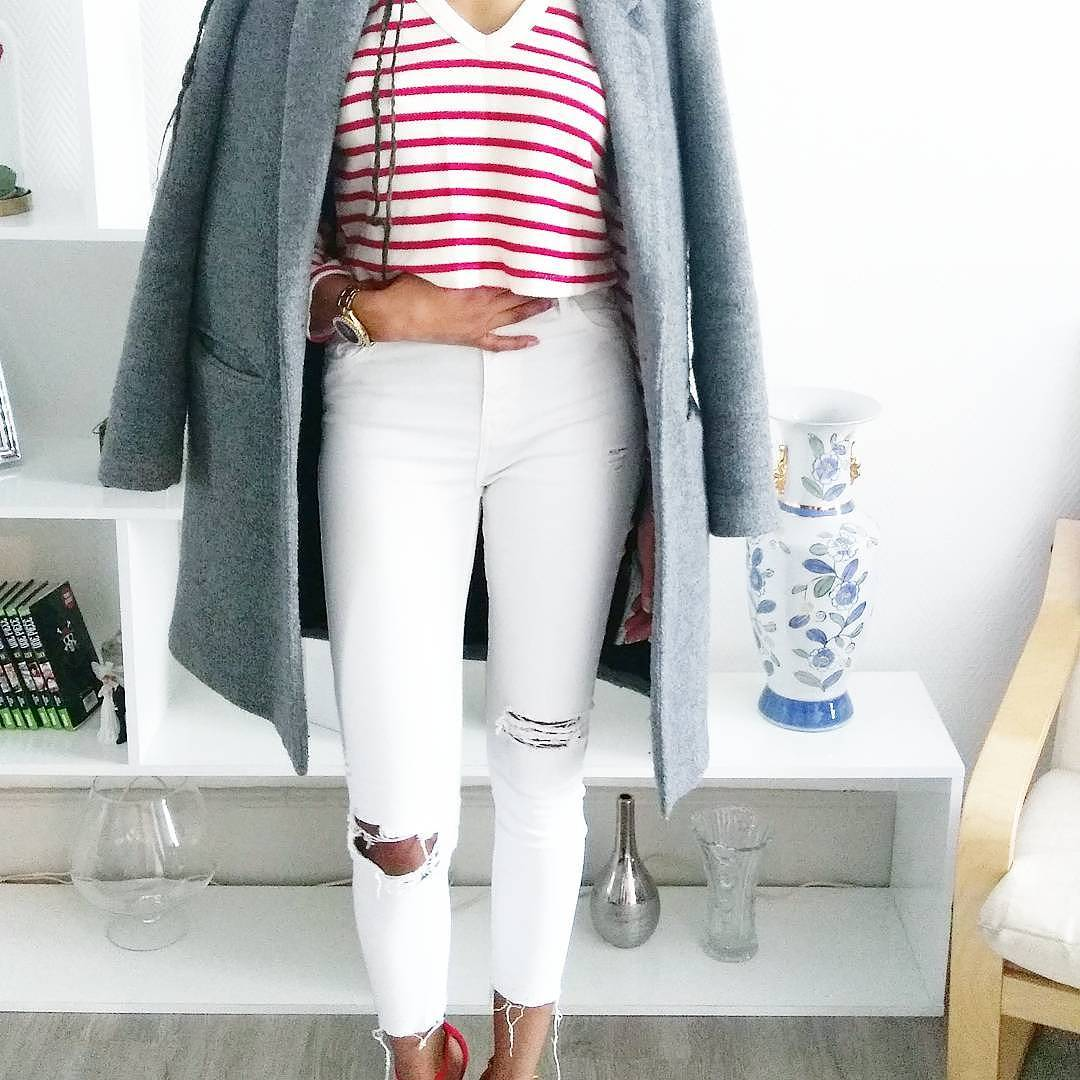 Smart V-Neck Stripes T-Shirt Paired With White Ripped Jeans And Warm Grey Coat Perfect For Formal Look