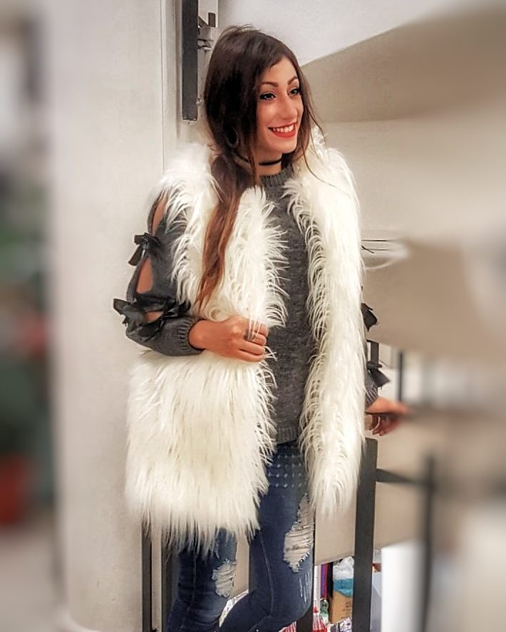 Striking Grey Sweater Paired With Faux Fur Half Sleeve Jacket And Jeans