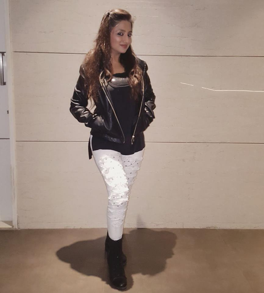 Stylish White Leather Pant Worn With Black Leather Jacket And Ankle Shoes