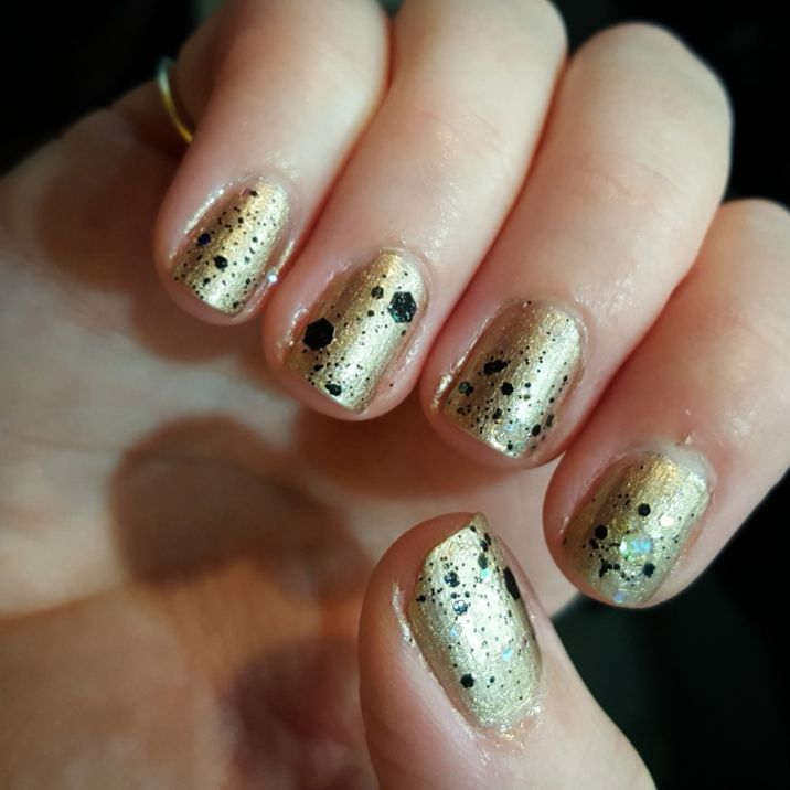 Swanky Golden Nails With Black Dots