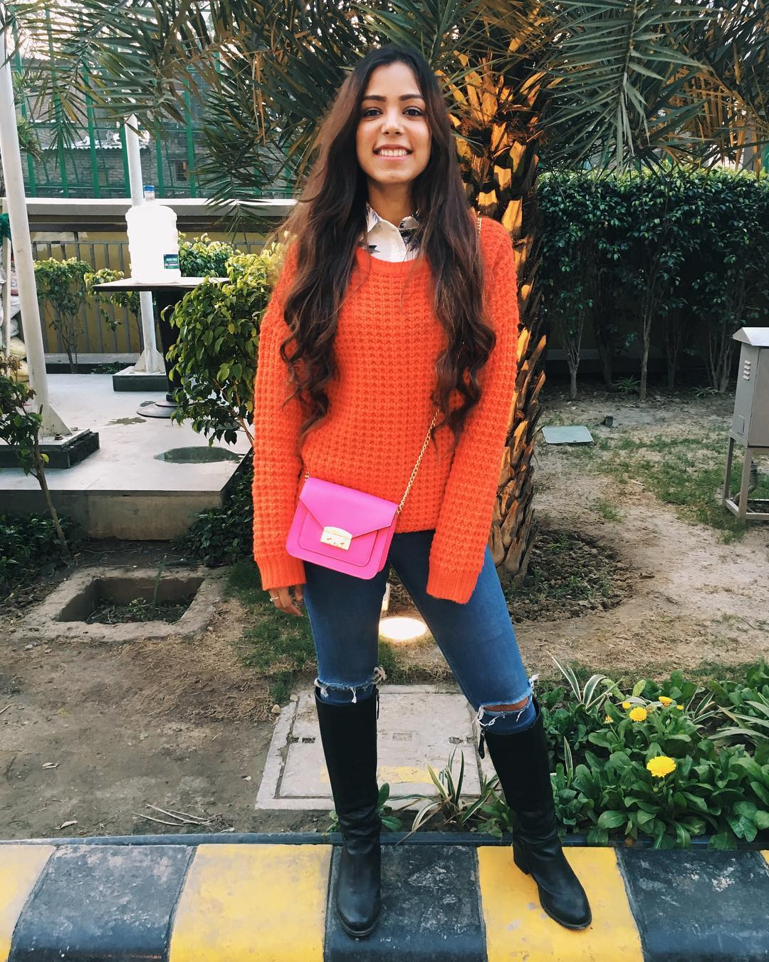 Swanky Orange Knitted Sweater With Ripped Jeans, Leather Shoes And Crossbody Pink Bag
