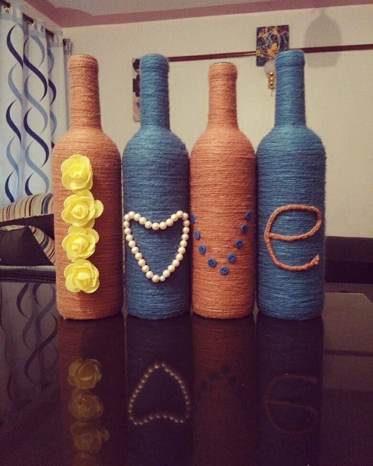 Old Wine Bottles Wrapped With Thread And Decorated For Valentine's Day