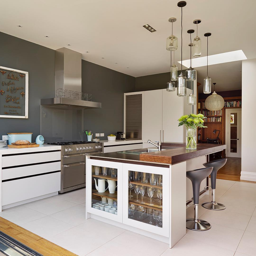 A Glazed Cabinet Finishes Off This Urbo Island With Smart Storage Idea