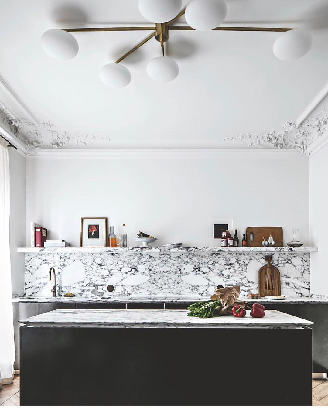 Arabescato Marble Looks Fabulous With Fancy Ceilings, Dark Cabinetry And Light Fixture