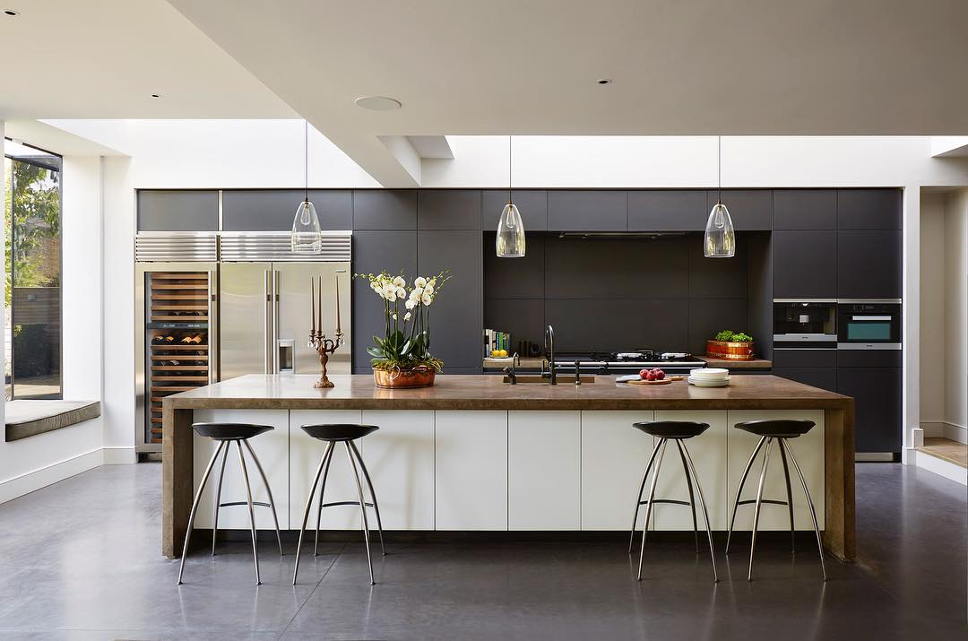 Bespoke Concrete Work Surfaces With White Cabinets