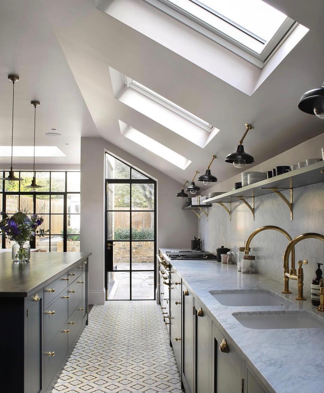 Brass Hardware, The Stone, The Windows And That Lighting Looks Cool In Contemporary Kitchen