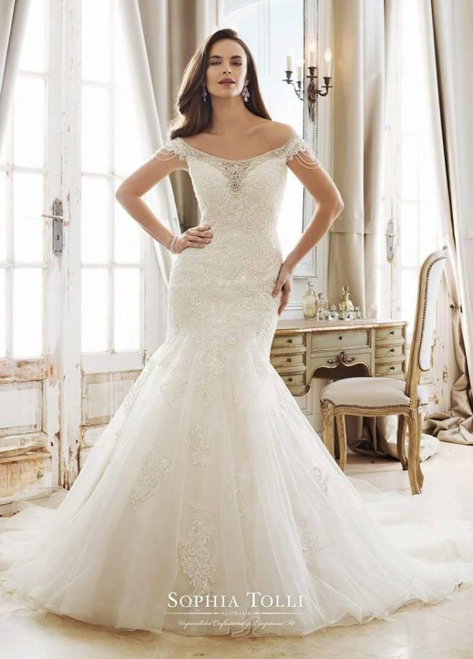 Captivating Ivory Lacy Finish Bridal Wear