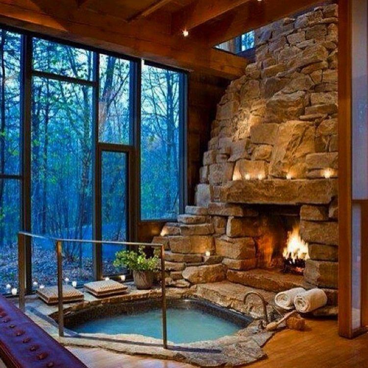 Fireplace Near Bathtub With Big Window