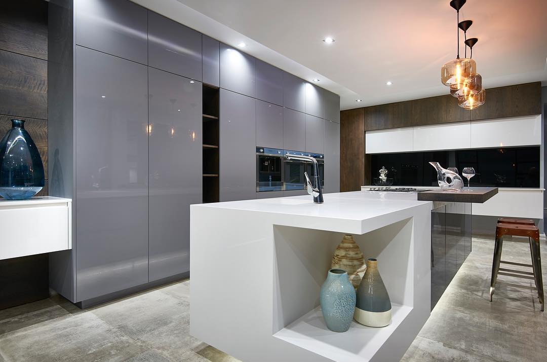 Luxury Grey High Gloss Units With Warm Wood Accents