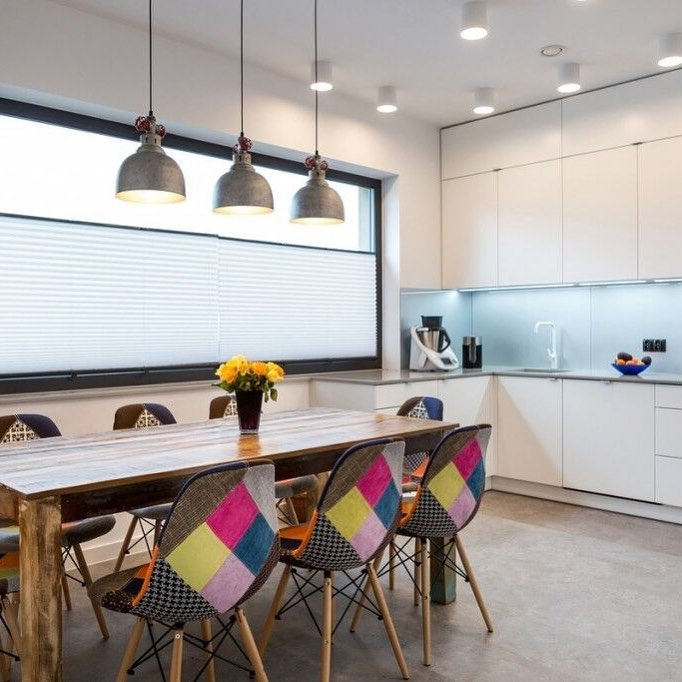 Nice Colorful Kitchen Chairs Make This White Contemporary Kitchen Pop
