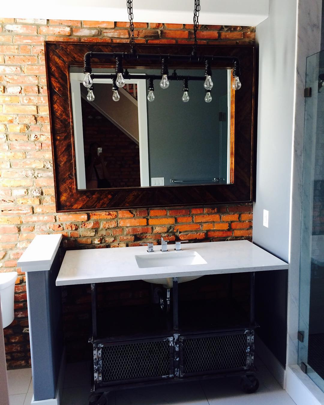 Old Iron Cart Used For Storage And Decorated In Industrial Touch Rustic Bathroom