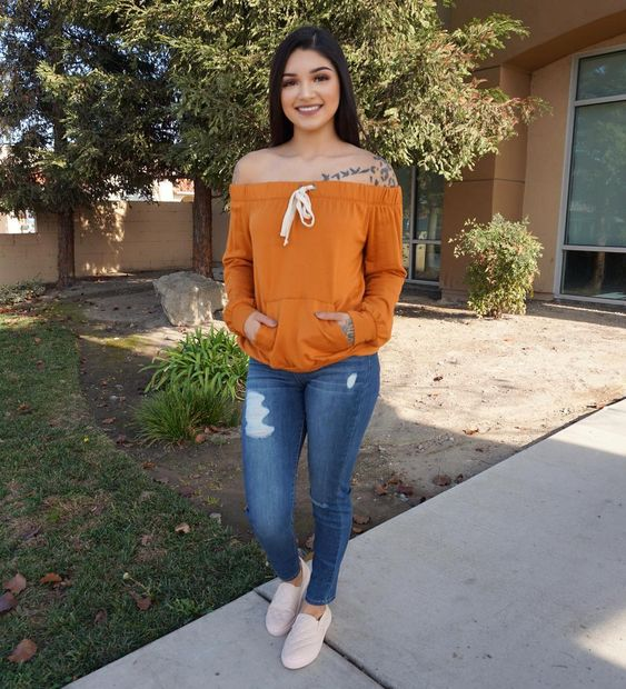 Orange Off Shoulder Drawstring Sweater With Ripped Jeans