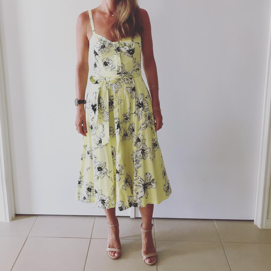 Simple Lemon Yellow Floral Midi With Waist Belt And high Heels Perfect For Summer