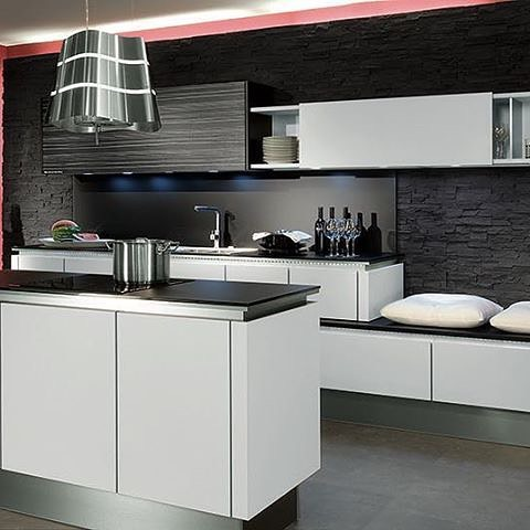 The White Acrylic Matte Finish Cabinet Doors Adds Contrast To The Dark Walls