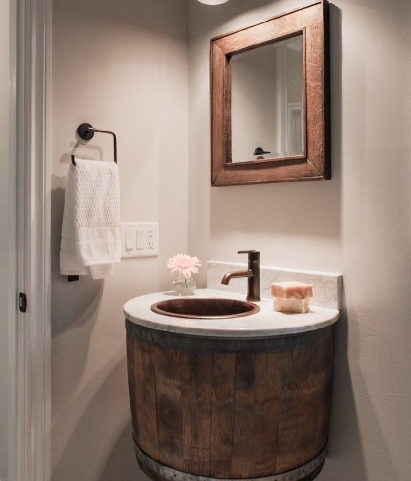 Wine Barrel Vanity Is Made From Oak Barrels And Wine-Stained Oaking Staves Used For Mirror