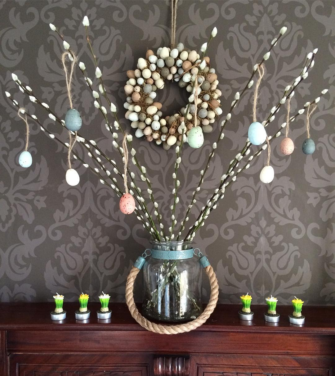 Appealing Easter Decor With Egg Garland And Tree In Glass Vase