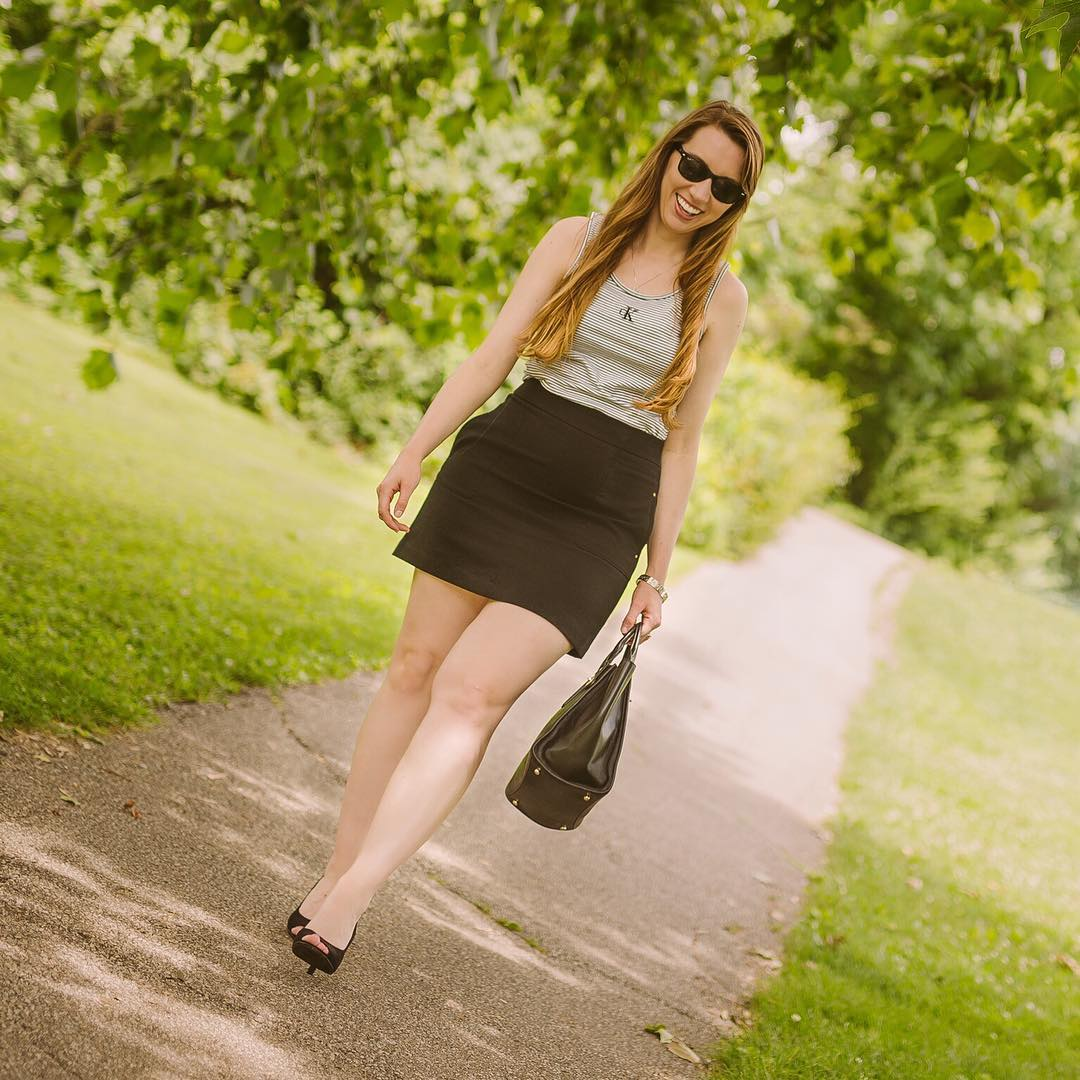 Black Mini Skirt With Monochromatic Top With Kitten Heels And Handbag