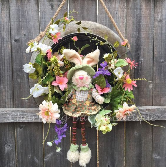 Galvanized Tire Is Decorated As Easter Wreath