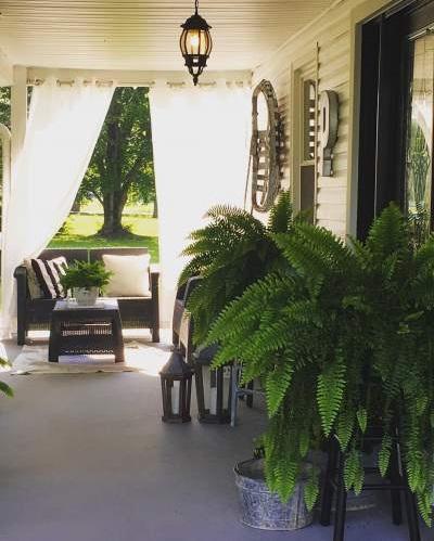Rasin Patio Sofa With Floor Lantern And Beautiful Plants